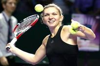 Giant-killer Halep looking forward to rematch with Serena