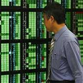 Asian stocks cheered by Fed reassurance, yen awaits BOJ