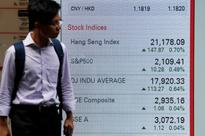 Asian shares at 15-month high, dollar soft on less hawkish Fed