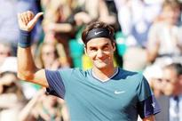 Federer ousts ailing Djokovic in semis