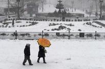 Snowstorm sweeps northeast U.S., New York spared its brunt