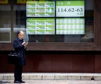 Asian shares firm, dollar and U.S. bond yields slip after Fed