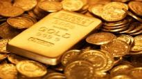 Gold holds losses but finds support near $1,300