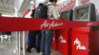 AirAsia Shares Fall as Much as Seven Percent After Reporting Three Losses