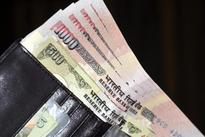 Rupee weakens to 67.96 in early trade