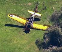 Harrison Ford survives after crash-landing vintage plane on golf course