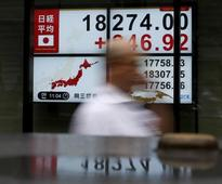 Asia stocks hesitant, dollar knocked after poor U.S. data