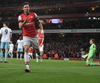 Podolski double gives Arsenal crucial win vs West Ham