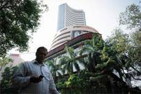 Sensex closes over 64 points down