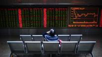 Dollar slips, Asian stocks on defensive after Trump's protectionist address