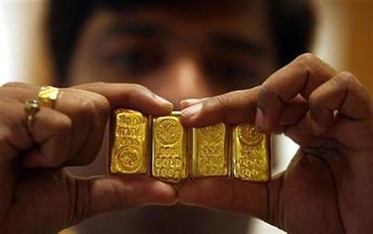 Gold declines on weak global cues, low demand