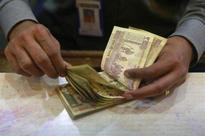Rupee, shares rally as opposition leads in exit polls