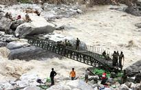 Mass cremation begins, 7,500 still await evacuation from Uttarakhand