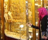 Gold edges above $1,200 as dollar pares gains