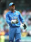 MS Dhoni spotted with gun